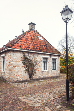 Bourtange, The Netherlands, November 7, 2017: The small houses in Bourtange, a Dutch fortified village in the province of Groningen in the north of the Netherlands