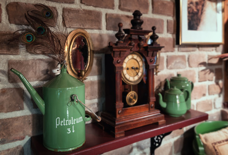 Musselkanaal, The Netherlands, November 7, 2017: Clock with cans on a shelf on the wall in a farm Editoriali