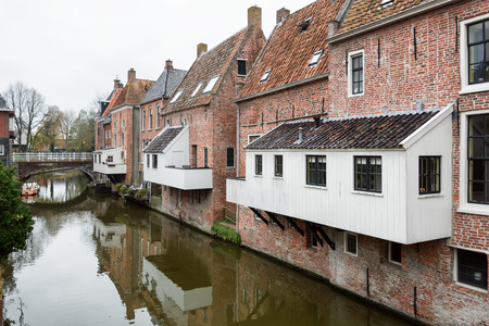 The famous hanging kitchens above the canal Damsterdiep in the village Appingedam in The Netherlands