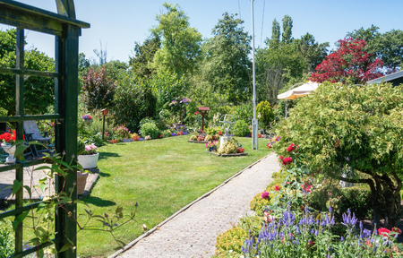 Zaandam, The Netherlands, July 2, 2018: Garden shed surrounded by a beautiful decorative garden in The Netherlands Editorial