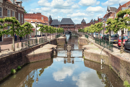The canal Eem with in the background the medieval gate The Koppelpoort in the city of Amersfoort in The Netherlands Editorial