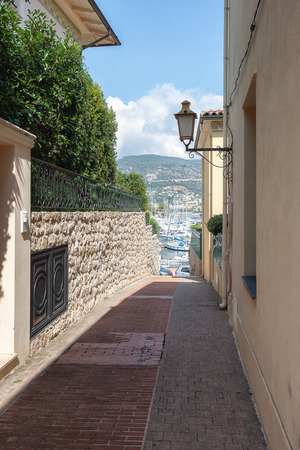 Narrow street leading to the harbor of the peninsula of Saint-Jean-Cap-Ferrat on the Cote d'Azur in France