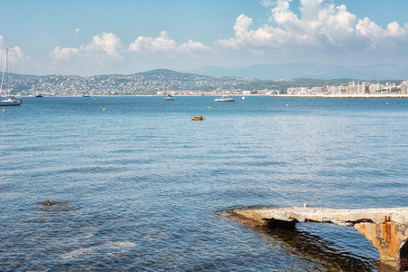 Juan-les-Pins, France, September 19, 2018: kayaker resting in the Golfe Juan with in the background the hotels of the French city of Juan-les-Pins