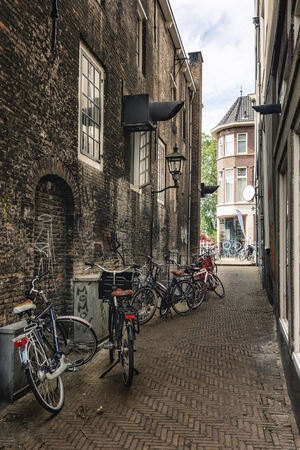 Delft, Netherlands, July 29, 2018: Impression of a narrow street in the old center of Delft in The Netherlands