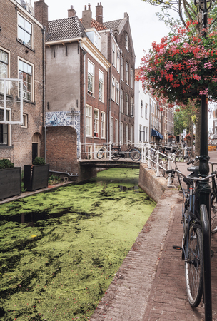 Delft, Netherlands, July 29, 2018: Bridge over the Voldersgracht in the old center of Delft in the Netherlands. Editorial