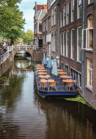 Delft, Netherlands, July 29, 2018: Floating terrace in the canal at the Wijnhaven in Delft in The Netherlands