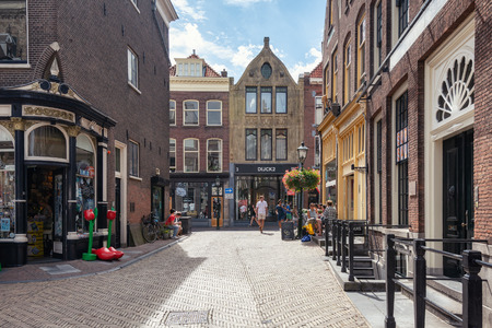 Delft, Netherlands, July 29, 2018: Impression of a street in the old center of Delft