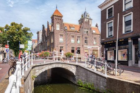 Delft, Netherlands, July 29, 2018:  The corner Ouden Langendijk and Koornmarkt in the Dutch city of Delft in The Netherlands