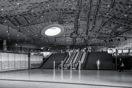 Delft, Netherlands, July 29, 2018:  Black and white picture of the hall with travelers in the Central Station Delft