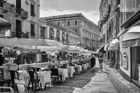 San Remo, Italy, September 18, 2018:  Black and white photo of the outside terrace of a restaurant on the via  Fransesco Corradi in the center of the Italian town San Remo