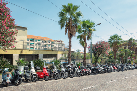 San Remo, Italy, September 18, 2018:  Motorcycles, scooters and mopeds parked on the via Bartolomeo Asquasciati in the center of the Italian town San Remo. Editorial