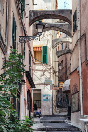 San Remo, Italy, September 18, 2018:  Impression of the narrow street Via Saccheri in the center of the Italian town San Remo