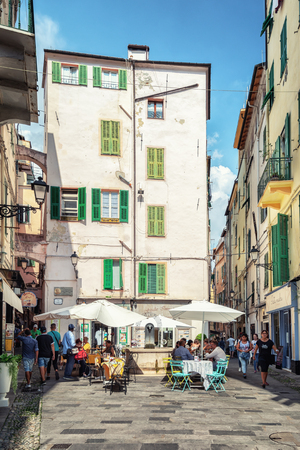 San Remo, Italy, September 18, 2018:  The outside terrace of a restaurant on the via  Fransesco Corradi in the center of the Italian town San Remo