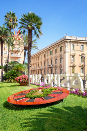 San Remo, Italy, September 18, 2018: Roulette wheel of flowers in the garden in front of the famous Casino in San Remo
