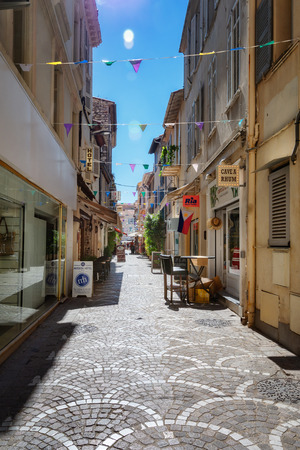 Antibes, France, September 11, 2018: Impression of the narrow street Rue Fourmillière in the old center of Antibes