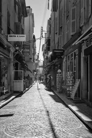 Antibes, France, September 11, 2018:  Black and white picture of the street Rue James Close in the old center of Antibes
