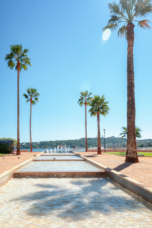 Pond with fountains located on the Antibes coastline in France