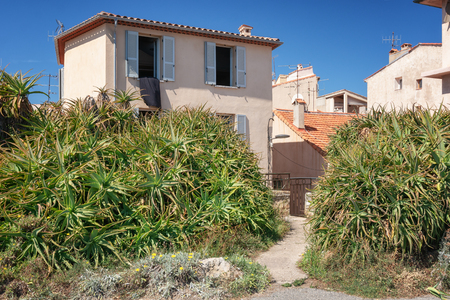 Antibes, France, September 11, 2018:  House along the promenade Amiral de Grasse in Antibes with huge succulents at the front