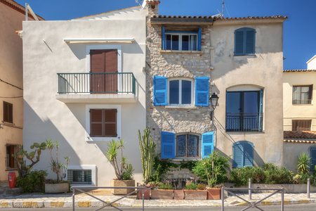 Antibes, France, September 11, 2018:  Colorful houses along the promenade Amiral de Grasse in Antibes