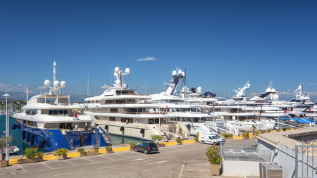 Antibes, France, September 11, 2018: The super yachts at anchor in the Port Vauban in the French town of Antibes Editorial