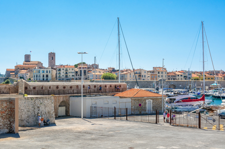 Antibes, France, September 11, 2018: The old city wall of Porte Vauban with in the background the old center of Antibes in France