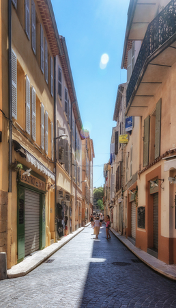 Antibes, France, September 11, 2018:  Impression of the narrow streets in the old center of Antibes in France Editorial