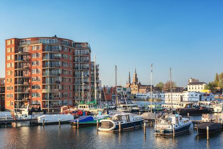 Zaandam, The Netherlands, April 18, 2019: Impression of Zaandam located along the river Zaan seen from the marina Redactioneel