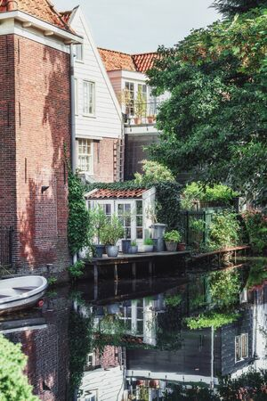 The small back garden located on a canal in Edam in the Netherlands