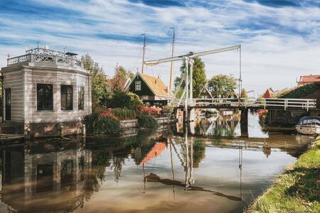 The Kwakelbrug bridge over the Nieuwe Haven canal with a beautiful Gazebo on the bank in Edam in the Netherlands