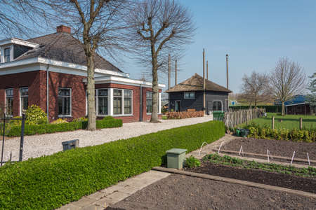 Nootdorp, The Netherlands, April 7, 2019:  Beautiful bungalow  with kitchen garden and a hay loft converted into a home situated between huge greenhouses