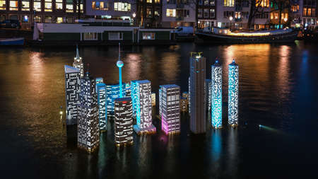 Amsterdam, The Netherlands, January 6, 2020:  Atlantis a sinking or flooded city as a warning for the rising sea level during the Light festival in Amsterdam