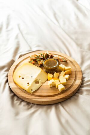 Cheese plate served with nuts, Top view. Assorted cheeses Camembert, Brie, Parmesan blue cheese, goat