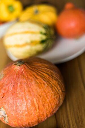 Autumn little pumpkins on a wooden table.
