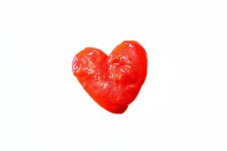 Red glitter slime in the form of a heart on whit background. Toy antistress. Toy for the development of hand motor skills.