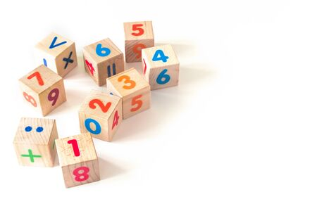 Kids toys wooden cubs with numbers on white background. Developing wooden blocks. Natural, eco-friendly toys for children. Top view. Flat lay. Copy space.