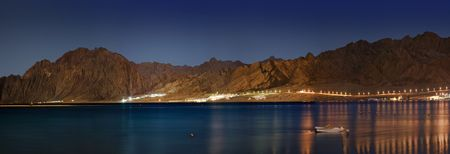 Panorama of a sea lagoon and night fires photo
