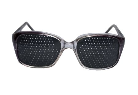 Black glasses with perforation for vision correction on a white background. Isolate