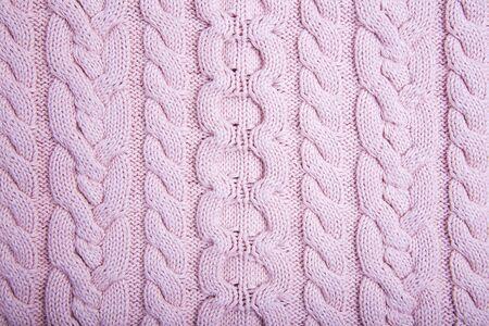 Gestrickte Stoff Textur. Rosa gestrickter Hintergrund. Moderner Pullover