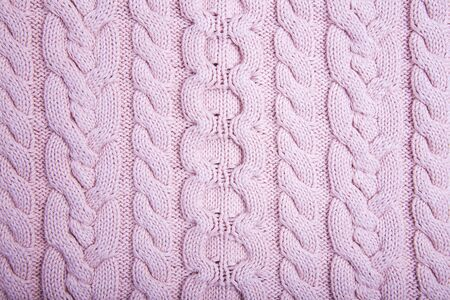 Knitted Fabric Texture. Pink Knitted Background. Modern sweater
