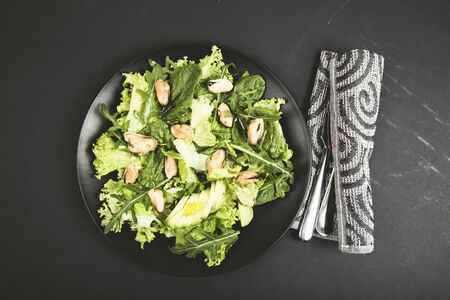 Healthy fresh salad with mussels, avocado, lettuce, spinach and arugula . Top view. Diet conception Reklamní fotografie