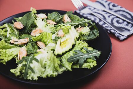 Healthy fresh salad with mussels, avocado, lettuce and arugula. Diet conception Reklamní fotografie
