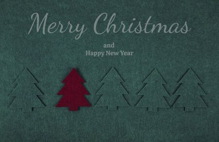 Christmas composition pattern background of green Christmas trees on green. Christmas and New Year concept. Banque d'images - 134802270