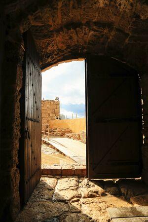 Old wooden door opened with beautiful view Reklamní fotografie