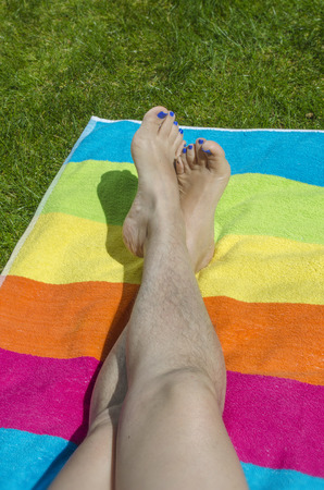 foots: Unshaven female legs in the pool