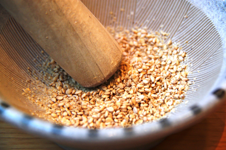 Grinding sesame Seeds in a Suribachi, Japanese mortar and pestle