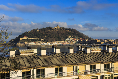 Landscape view from Izaburu Kalea of the Old Town and mount Urgull in San Sebastian, Spain Editorial