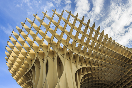 Seville, Spain - Dec 2018: Bottom up view of Mushrooms of Seville , also known as Metropol Parasol. It was designed by the German architect Jurgen Mayer and was completed in 2011