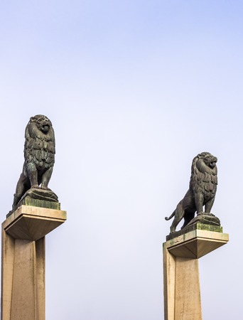 Zaragoza, Spain - Jan 2019 - Stone lion statues on pillar guarding the Puente de Piedra (Bridge of Lions). The lions were designed by Francisco Rallo Lahoz Editorial