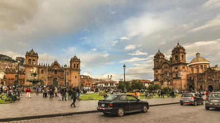 Cusco, Peru - Jan 2015: Plaza de Armas with Church of the Society of Jesus on the right and Cusco Cathedral on teh left