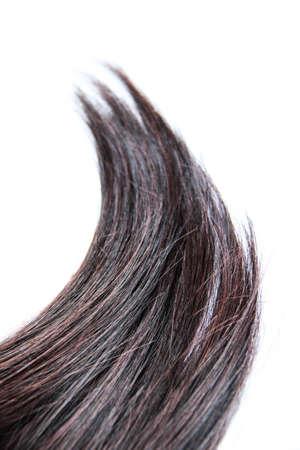 Black hair isolated on white background. Brunette natural hair extension on white background